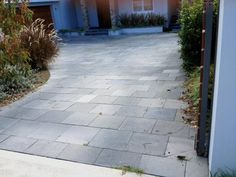 Driveway paved with charcoal limestone pavers supplied by Gaia Stone