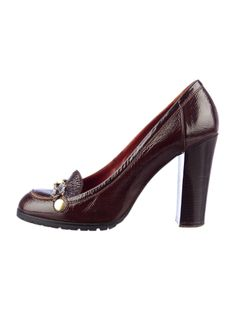 Brown patent leather round toe pumps with silver-tone chain at toes, stacked heels and rubber soles.