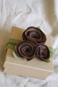 Rosette package topper. Great idea to use two different shades for the flower!