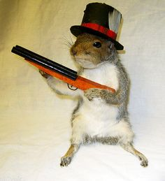 Stuffed squirrel with a top hat and a shot gun... Regretsy