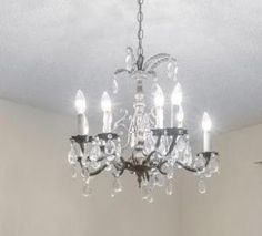 Folk Art Sewing: Beautiful Vintage Chandelier - found in a Home for...