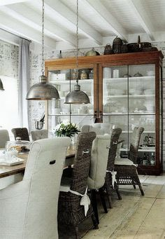 Exposed beams, glass front cabinet, pendant lights, rustic floor.  Many elements to love!