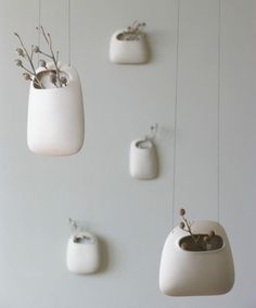 Clay pods. The method of hanging is very attractive. Could even use a bead inside to guarantee a good connection.