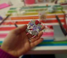 Little pony with violet hair and a Little Red baloon :) hand made with polymer clay.