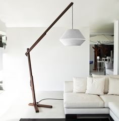 Floor lamp with base in Canaletto walnut wood and shade in white cotton and white macrame lace.