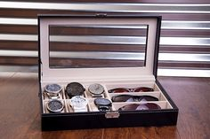 Black Leather Sunglass & Watch Organizer - Watch Box ENGRAVED COMBO JEWELRY DISPLAY, VALET BOX Luxury black leather watch and sunglass box,jewelry organizer with glass top display. Case holds up to 6 watches and 3 sunglasses. WHAT'S INCLUDED: -Luxury Sunglass Box -Microfiber Cleaning Cloth -Lock Latch & Key -Canvas Travel Bag #Watchbox #WatchCase #WatchOrganizer #signaturethings