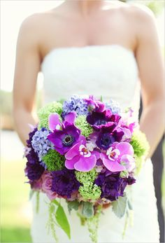 Purple wedding bouquet. This has so many different flowers, its beautiful!