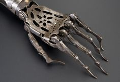 Victorian steel prosthetic arm  beautiful in it's design