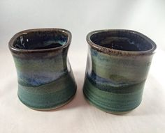 Set of 2 stoneware ergonomic pottery cups, green, black, and glossy blue glaze (6 oz)-great for sake, espresso, wine, mead, tea, juice! - pinned by pin4etsy.com