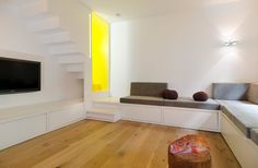 Two apartments become one - linked by a lemon yellow stair.