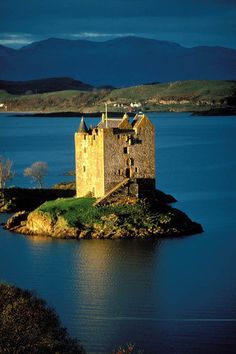 Castle Stalker, Loch Linnhe, Scotland - a four-story tower house or keep. The original castle was a small fort, built around 1320 by Clan MacDougall who were then Lords of Lorn. The castle was lost in a card game to a member of the Campbell Clan. Scotland Castles, Scottish Castles, Oban Scotland, Oh The Places You'll Go, Places To Travel, Places To Visit, Beautiful Castles, Beautiful Places, Chateau Medieval