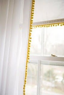 pom pom trim curtains- maybe just add trim to existing roman shades and add white drapes with pom pom trim