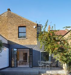 Hexagonal slate tiles cover this west London home extension.