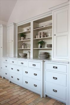 Combination of a Grand Chest of Drawers Base Cabinet and two Pan Drawer base units to provide ample storage space