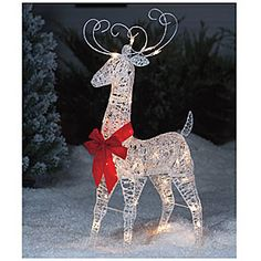"""38"""" White Glitter Deer  $25    This regal deer is sure to add elegance to you outdoor decorating this Christmas!        50% metal, 50% plastic      35 mini UL® lights"""