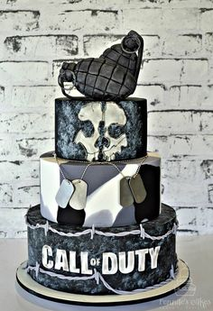 Call of Duty Cake Call of Duty Ghosts cake, with barbed wire, fondant grenades, and camouflage fondant.