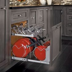 some of the best kitchen cabinet organizers have hardware for specific items being stored like this pull-out for pots & their lids