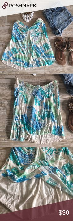 """•Free People• Tie Dyed Tube Top This top is so pretty and flirty! I've just figured out that tube tops are not my most flattering cut, otherwise I would not be parting with this! So easy for summer! Cut slightly longer in the front and has a double layer in the front so it's not sheer. Worn a few times, and is in excellent condition (could just use a good steam, it's been packed away with my summer stuff!) Size Small.   Measurements (taken laying flat); Front: (front knot to bottom) ~15""""…"""