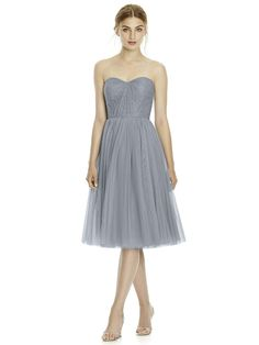 This Jenny Yoo JY535 convertible bridesmaid dress offers a choice of necklines on the strapless sweetheart Florentine lace bodice with a semi-open back. This cocktail-length dress has a lightly gathered A-line skirt, styled in soft tulle with a knee-length hemline. The sheer tulle convertible straps can create a one-shoulder asymmetrical neckline or a halter neckline and waist sash.