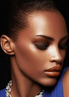 Her skin tone against her lipstick is beautiful. #bronze on #bronze