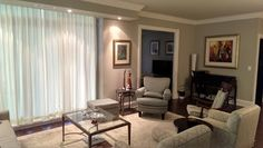 These unlined custom silk drapes allow light in while still providing privacy.
