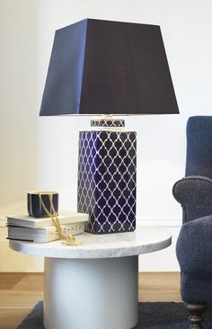 The Beacon Lighting Madras square table lamp with geometric patterned base in blue with blue shade