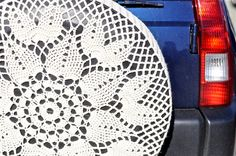 Crocheted spare tire cover! Makes me wish I had a spare tire mounted on the exterior of my car!