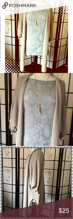 "Express Creamy Tan Cardigan Knit Sweater ✨ GORGEOUS CREAMY Tan Cardigan Knit Sweater with Side Slits. Great ""Go To"" Cardi to Throw On Over Anything & Everything! Size is Large, but Can be Worn By a Small or Medium as a Oversized Cardigan! Feel Free to Ask Questions 🌟 Express Sweaters Cardigans"