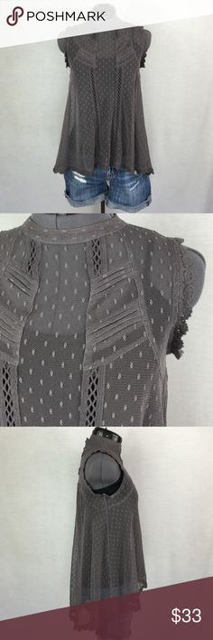 Free People High Neck Sleeveless Lace Top So Cute! Beautiful gray lace with pin-tucks and crochet inserts for detail. High neck design, high-low hemline. A-line shape. 7 button up back. Bust Approximately 17 inches flat across, shoulder to front hem is approx 23 inches. Size XS, TTS. In excellent condition. Free People Tops Tank Tops