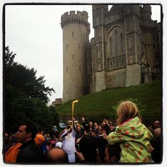 The Olympic Torch in Arundel C/O our home town by www.pearlandearl.com