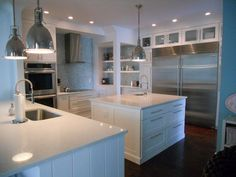 White Quartz Countertops- NO Granite. It's ugly & you can't ever tell if it's really clean. Gross!!!