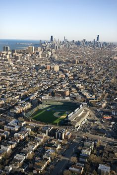 Chicago, Illinois. - Aerial view of Wrigley Field with Chicago, Illinois skyline in background. Pinned by #CarltonInnMidway - www.carltoninnmidway.com