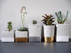 Wojtkowiak molds the planters in used almond milk containers and adds silver or gold leaf, or enamel.--would make lovely cernterpieces