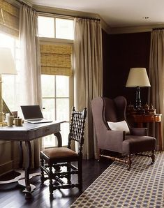 Full neutral draperies paired with woven wood shades in this handsome room| steven gambrel seaside