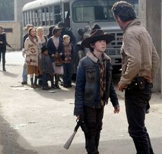 Carl Grimes, Rick Grimes leading the group.