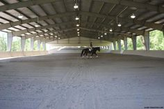 Covered horse riding arena with large clearspan width. Fully customizable for your roping and dressage needs.  http://www.ironbuiltbuildings.com/metal-building-types/riding-arenas/