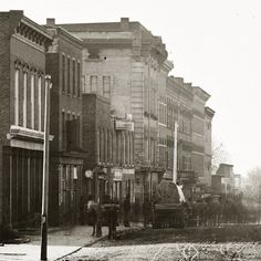 Whitehall Street, Atlanta, 1864  Sherman's men burn two textile mills in Roswell and send 600 workers north as prisoners. Atlantans panic and flee. Soon, eighty percent of Atlanta's residents are refugees…