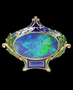 Marcus & Co. - An Art Nouveau brooch, about 1900, New York. Enamelled gold set with opal. 3.6 x 4.2cm. #Marcus #ArtNouveau #brooch