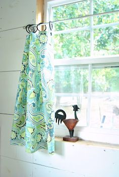 You could make this out of a small piece of coordinating shower curtain for a window inside the shower space.