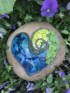 Mosaic Garden Art - A signed, one-of-a-kind, original piece of art for your garden. Hand-crafted, blown glass has iridescent qualities to reflect the sunlight and add sparkle to your garden. Being created on an actual river rock gives this piece substantial weight and durability to withstand even the harshest weather. Approx. 6 in height and approx. 8 pounds. Commissions happily accepted! Contact me for price quote.