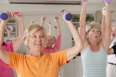 Seniors exercising with dumbbells in a health club