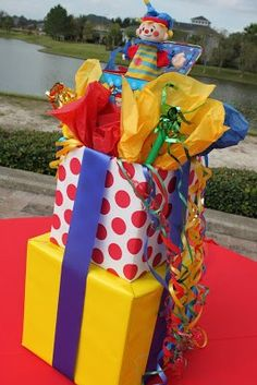 Great kids birthday party ideas on how to wrapped boxes as centerpieces, cute idea easy to customize. Can use this to make a bigger version boxes to put presents in for your child's birthday party as well. So many ideas! Clown Party, Circus Carnival Party, Circus Theme Party, Carnival Birthday Parties, Circus Birthday, Birthday Party Themes, Birthday Ideas, Diy Carnival, Themed Parties
