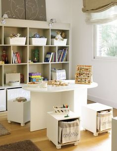 Open cubes can double as storage and seating in a small apartment.  When not in use, they neatly roll under the table to save space.