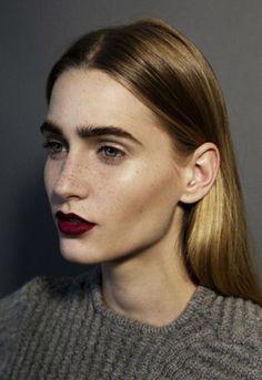 Feral brows/freckles/cheekbones/matte lipstick/red lipstick/matte/contour/fashion/eyebrows