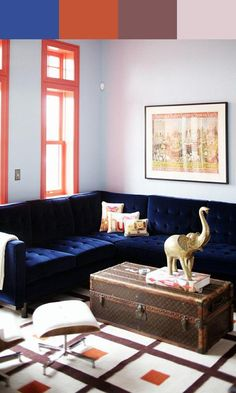 That blue velvet sectional is to die for. Not to mention the gold elephant and the trunk. Swoon.