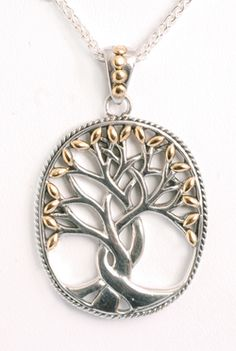 Tree of Life... earthy, silver... nice. Might look better antiqued.