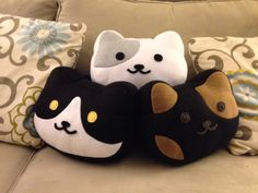 This is a pillow inspired by the cat collecting mobile game, Neko Atsume. Its 100% hand sewn and is about 12 inches across and 8 inches tall, made