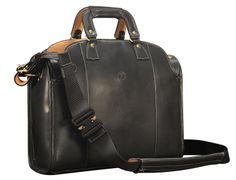 Hand-burnished black Deal Bag with natural leather trim, royal blue grosgrain lining and cross body shoulder strap; 17 x 12 x 5″ - front view glaserdesigns.wordpress.com www.glaserdesigns.com