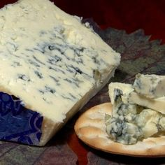 Bleu D Auvergne AOC 50% - is a respected AOC cheese. It was first created in 1854 by a Roquefort maker and is very popular among cheese lovers all over the world. It is made from cow's milk and has 50% fat content. Penicillin Roquefort is inoculated into the milk. Bleu D' Auvergne is spicy and salty with a hint of wild flowers that gives it quite an Earthly taste. It ages for about a month before it is sold on the marketplace.