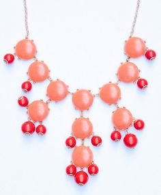 Gorgeous Coral Bubble Statement Necklace. This J. Crew inspired necklace is a wonderful addition to any outfit! This one simple piece can help you make a big statement! Save money, and have people think you spent $150 for this beautiful piece of jewelry!    Shipping: $2.50 + Free for additional i...